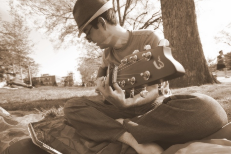 Rodrigo playing acoustic guitar